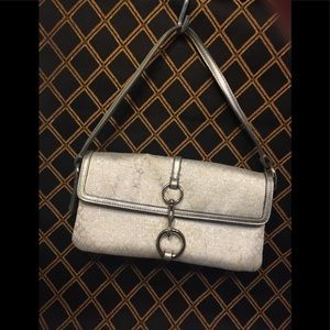 Small handbag of silver, & white by Coach.